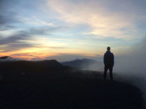 Haakon looking at the sunrise from the crater of Telica